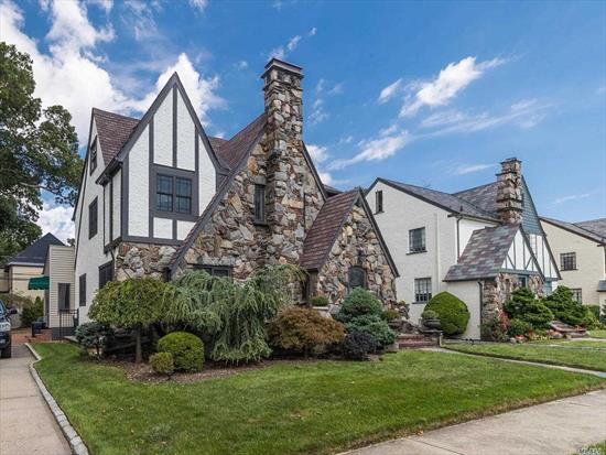 Incredible Home w/ Large Rooms and so much space to live & entertain! A Bright but Classic Tudor w/ all New Windows, New Roof, Paint & gorgeous hardwood floors. Enter thru the large Foyer boasting Coat Closet & Powder Room. Step down to Oversized LR w/ FPL, FDR flowing into Updated Eat In Kitchen w/ Large Center Island. Family Room is right off kitchen w/windows overlooking Private yard. Master Suite has new bath & double closets, 2 more bedrooms & a large family bath. Basement is a must see!
