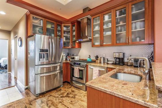 Enjoy Gold Coast living along Hoboken's desirable Garden Street in this top floor 2 bed / 1 bath condo. Fully renovated with approx 900sqft, this home featuring a 10.5 ft ceiling, hardwood floors throughout, and recessed lighting. The state-of-the-art kitchen features custom cabinetry, granite countertops with a breakfast bar, stainless steel Electrolux appliances and tray ceiling with lighting. Enjoy natural light from the large living room skylight and an alcove perfect for a home office. Spacious bedrooms with modern ceiling fans and oversized windows, plus enjoy the beautiful NYC view from the master bedroom. The updated bathroom offers plenty of storage, granite counters, and a large Jacuzzi tub. Completing the unit, enjoy the convenience of an in-home washer and dryer, central A/C and heating, a storage nook, and extra storage with a gated 6 x 10 storage unit. Perfect locations with close proximity to local restaurants, activities, shopping and transportation.