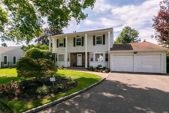 Live in this beautiful tree-lined neighborhood. Fabulous Colonial with a huge park-like backyard and a gigantic in-ground pool in Highly rated Syosset schools, New stainless steel appliances, new central air conditioning. Large Master bedroom w/ spa tub. Office on the main floor, Skylight in the den, New water heater and custom railing on stairs