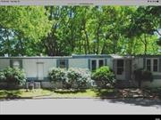 Cash sale. Desirable pet friendly family community. 2 bdrms, large expanded living room, dining room, kitchen, full bath with washer / dryer. Covered deck and patio includes shed with private yard backing up to green space. Updated windows. Lot rent $550 Mo. INCLUDES taxes, water, trash/snow removal and cesspool maintenance. Minutes away from all the North Fork has to offer: shopping, wineries, restaurants, beaches, boating, fishing, golf, farmstands, Tanger outlet and Splish splash waterpark.