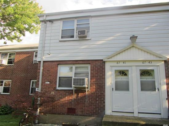 Beautiful 2 Bedrooms Duplex Unit, Located inside Quiet Courtyard near Bell Blvd, Private Front and Back Door, Low Maintenance Includes all but Electric, Washer & Dryer in the Unit, Hard Wood Floor, Open Modern Kitchen w/Breakfast Bar, Pull down ladder w/Spacious Attic, Close to Schools, SD26, PS46/MS74, Convenient to all Bus Q27/88 QM5/8/35 to NYC, Move in Condition!