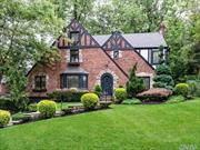 Classic Brick & Stucco Tudor in South Strathmore. Living room w/gas fireplace, formal dining room, beautifully appointed granite kitchen w/stainless steel appliances & access thru sliding door to bluestone patio & flat yard, den w/gas fireplace, bedroom & .5 bath. 2nd floor master bedroom & master bath w/steam shower, high-end Dornbraht fixtures, + 2 BRS & full bath. 2-car tandem garage, new driveway, Generator Hook-Up. Munsey Park Elementary.