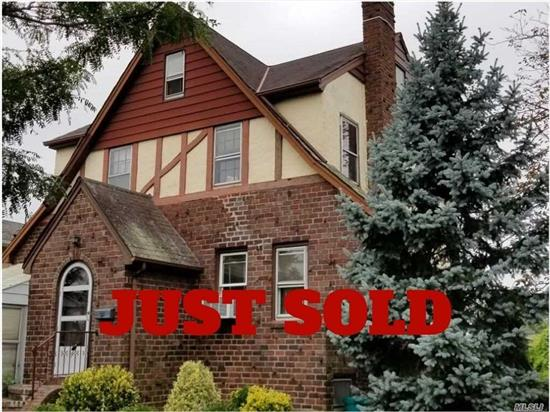 Solid Brick/ Stucco Tudor Colonial Home On Tree-Lined Street. Entrance Hall, Comfortable Living Room w/ Fireplace, Formal Dining Room, Eat-In-Kitchen. Oversize Property, Hard/Wood floors under the carpet, New Boiler and Electrical Panel. Needs Work. Close To Shops And Transportation. 25 Minutes To Brooklyn, 20 Minutes To Queens And 35 Minutes To Manhattan Via Lirr And More...
