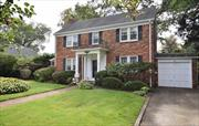 THE HOME YOU HAVE BEEN WAITING FOR! THIS IMPRESSIVE ONE OF A KIND SOLID BRICK COLONIAL IS SET ON A SPACIOUS 70 X 100 LOT AND ON A PRIVATE TREE LINED STREET. LARGE ROOMS THROUGHOUT, CUSTOM MOLDING AND BEAUTIFUL OAK FLOORING ADD TO ITS' SPECIAL FEATURES. TWO WALK IN CLOSETS IN MASTER BEDROOM AND A HUGE WALK UP ATTIC. CONVENIENT WALK TO THE HEART OF THE VILLAGE AND TRANSPORTATION. TRULY A MUST SEE!