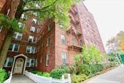 Just Listed In Beautiful Kew Gardens! A Beautiful 2 Bdr / 2 Bth Unit Only Steps Away from Express Trains, LIRR, and Buses, This 1400 sf Home in a Pet-Friendly Pre-War Building is Complete with Large Bright Rooms, Renovated Bathrooms, H/W floors, and High Ceilings. Building Amenities Include renovated laundry room, bike storage/storage available, and on-site porter. A Short walk to markets, gyms, schools, and shops. Zoned For PS 99. Schedule a Showing Today!