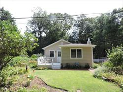 Picture perfect home in Private community a short walk to beach & nature trails! Surrounded by magnificent perennial gardens this gem offers new custom chefs kitchen with quartz counters & custom cabinetry, Custom Moldings & gleaming wood floors. New bath, most new Andersen windows. Newer roof. Totally remodeled 6 years ago! Privacy & Space in a picture perfect setting!