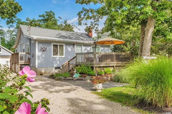 Nestled between the shimmering Peconic Bay & Bucolic Farmland is the Beach house you've been searching for! 100 feet from your deeded sugar-sand beach. Charming, Renovated 3 BR/ 2 Bath cottage. Wide plank wood floors. Chef's kitchen with stainless appliances, granite counters, double oven. Room to entertain both inside & out. Big 2 car detached garage. Low maintenance piece of property. Close to world class golf. Located on a quiet, private road but convenient to the best of the North Fork!