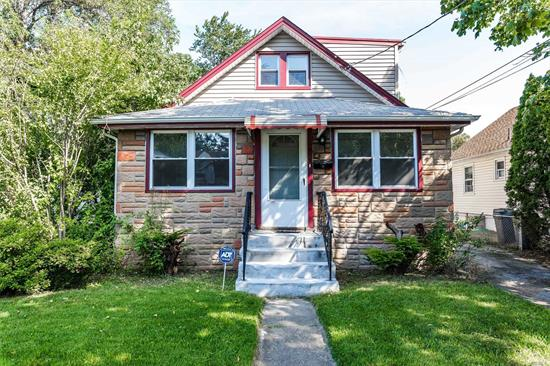 4 Bedroom 1 Bath Cape Consisting of Living Room, Kitchen, Den, Young Roof, New Windows, Gas in the house. Mid Block On Tree Lined St Close To All!.