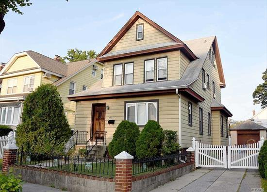 Wonderfully large 2067 sqft home on a quiet street. Sunroom, large living room with fireplace, formal dining room, and eat-in kitchen. 3 large bedrooms and full bath, walk up attic and large back yard. Convenient to LIRR and all mass transit. PS 32 and IS 25 schools.