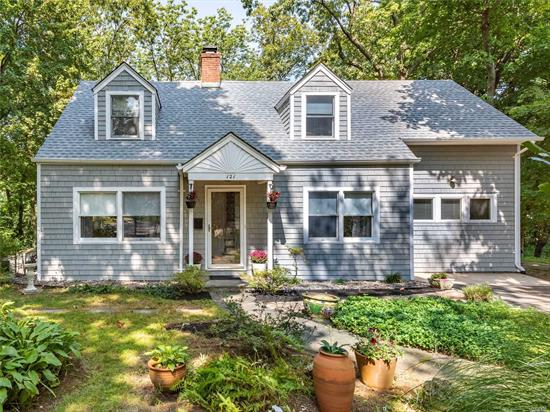 Charming Colonial in the Village of Roslyn, Surrounded By Almost A Half Acre Of Land In a Private Setting. Handsome Windows Provide Views Of Treetops And Property From Every Room. A 16x19 Mahogany Deck is Accessed Thru Glass Doors From Spacious Living Room/FP, Walk-Out-Basement Offers Many Possibilities For Expansion. This Home Features A New Architectural Roof, Newly Painted Exterior, New Gas Boiler, CAC, Updated Baths, Oversized Den and Designer Kitchen. Taxes are being Grieved