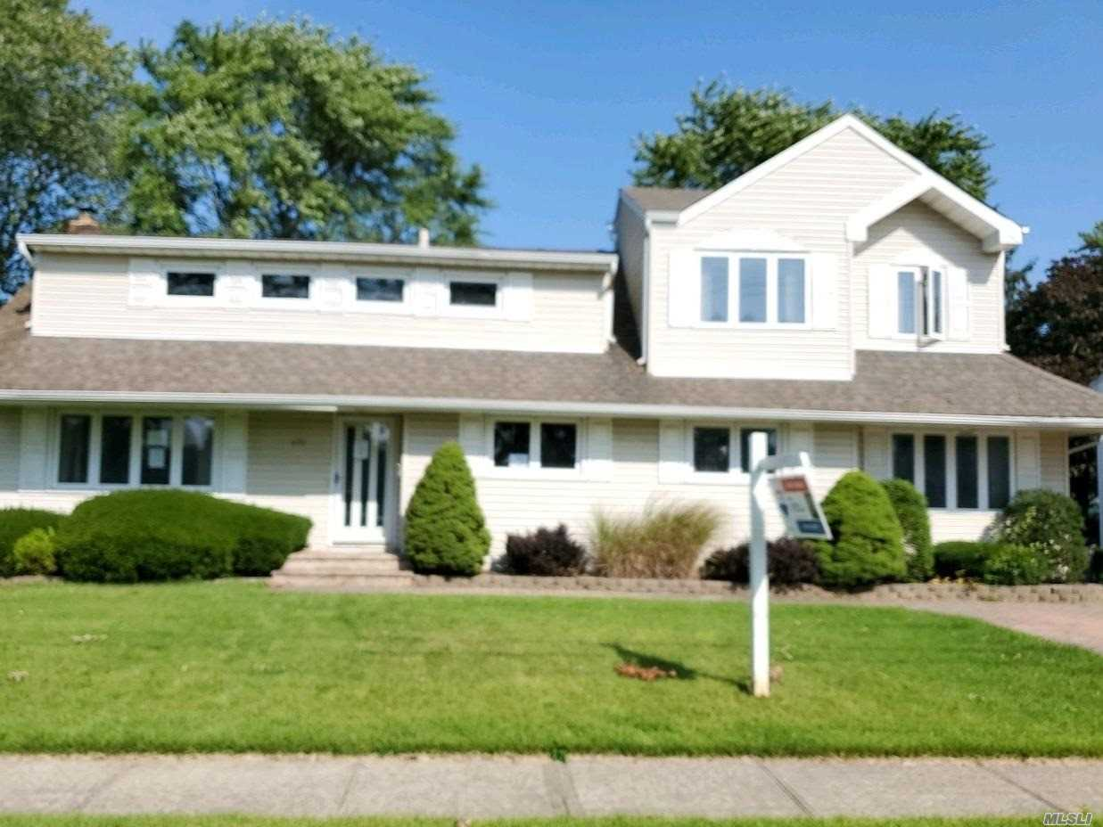 Spacious Split with 5 bedrooms and 2.5 baths. West islip schools. Perfect yard for Entertaining.