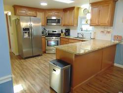 Priced to sell ! Beautiful, clean, move in ready unit in desirable Foxwoods Village. This home has a large master bedroom and bath, with plenty of closets. Kitchen has granite counter tops, stainless steel appliances with a first floor laundry. . . Wonderful Florida room for 3 season living. Brand new furnace !!! Close to clubhouse with pool and bocci ball. Pets are allowed. HOA fee $543 per month.