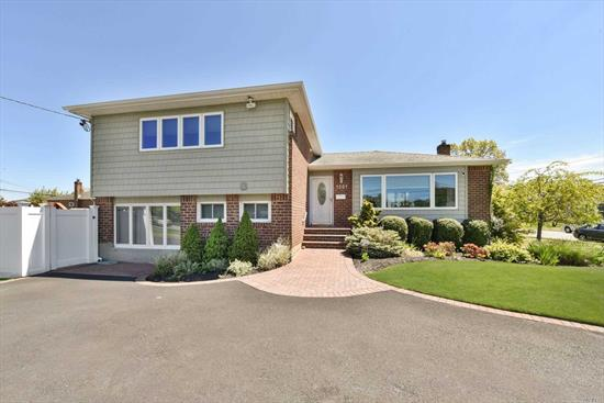 Clean & Meticulous Split Level Home Located In Massapequa Park.This Home Features Hardwood Flrs, Andersen Windows, 10 Yr Old Roof, 1 Yr Old Heating Sys & Hw Heater, 2 Yr Old Siding, 200 Amp Svc, Main level Features Eik W/Custom Cabs, Granite Cntr Top & 1 Year Old SS Appls, Liv Rm & Fdr.Top Level Has Master W/Half Bath, Wic & Laundry Rm, 2 Bdrms & Full Bath. The Lower Level Has A Den W/Full Bath, Bdrm & Ose. Fully Fenced Private Yard, In-Ground Sprinklers, 6 Car Circular Driveway.Poss M/D With Proper Permits