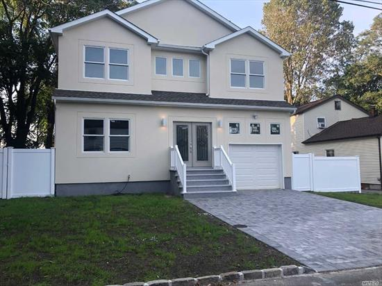 DIAMOND NEW CONSTRUCTION HOME HAS OPEN CONCEPT HIGH CEILING 52 HIGH HATS LOTS OF WINDOWS.HOME OFFERS QUARTS COUNTERS, WOOD FLOORS IN MOST ROOMS , WHITE VINYL FENCE, STUCCO OUTSIDE. CLOSE TO LIRR, SUNRISE, SHOPPING , RESTAURANTS AND MUCH MORE.