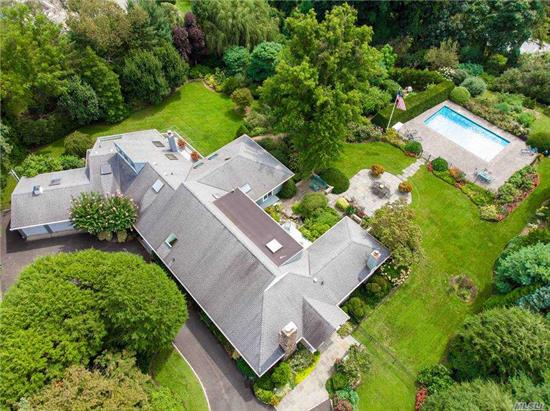 This extraordinary home is situated on 1.8 acres of lush plantings, an Alice Recjknahel Trey Japanese garden with ponds, deeded water-views of Manhasset Bay and gunite swimming pool. A nature lovers dream. Spacious living room with fireplace, den with delft-tiled fireplace and office, large formal dining room, sun-room, updated eat in kitchen, Master bedroom 2 Master baths, plus 5 additional bedrooms