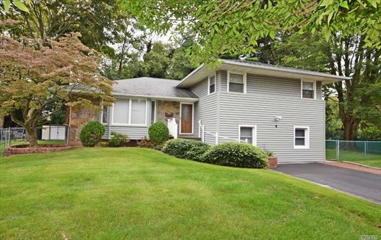 Large Split Aprox 2600 SF,  Situated on .22 acre,  Large Rooms 3 Spacious Bedrooms and 3 Full Baths. Two car garage were converted to storage rooms. Taxes are being grieved .  A 18 % or more reduction is expected Owner is willing to give a credit.