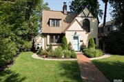 Charming 3-Bedroom Tudor, down the block from train and Plandome Road shops and restaurants. CAC and a wood-burning fireplace, flooded with natural light. Full basement and an oversized driveway with detached 2-car garage. This generous plot features mature landscaping throughout. Take advantage of all Manhasset has to offer, 1/10th of a mile from train to Manhattan.