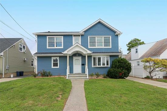A Home Run!! Possible Mother/Daughter w/proper permits. Beautiful curb appeal. Newly UPDATED IN 2015! Large Colonial boasts over-sized bedrooms & closets, 2 recently updated bathrooms, granite EIK, Large 1.5 detached garage. 200 AMP service. Not to be missed! Mid Block! Spectacular!