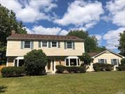 Eton 4 Bdrm Colonial in M Section of Stony Brook, Sparkling hardwood Flrs 1st & 2nd Flr (Laminate in Den) , Lr w/ Fpl, Many Andersen Windows, Hi Hats, 2.5 Baths, Brand New Stove, Den w/ Slider to Patio, 2 Car Garage with Side entrance, expanded driveway enters on quiet Cul-De- Sac, Fenced Yard, In Renowned Three Village SD