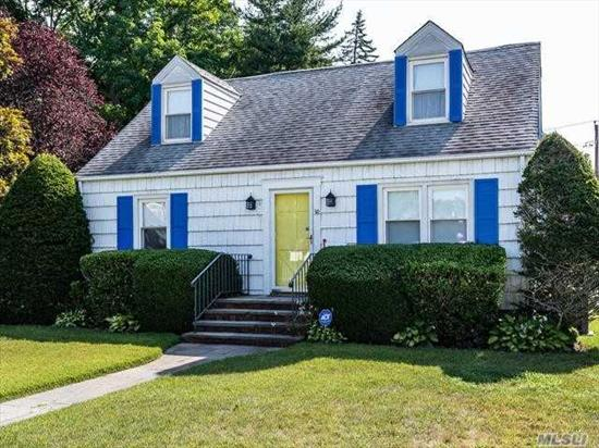 Beautifully Maintained Sun filled Dormered Cape in sidewalk neighborhood. Wood floors, CAC, gas heat, 3 Bedrooms, 2 baths, Lrm, Den/4Brm, EIK. 1 Car Garage. Lots of Closets.