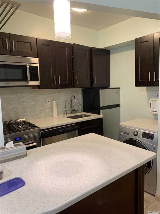 Renovated first floor apartment with backyard. Washer & Dryer in the apartment, all new appliances, built in water filter. Large closets and hardwood floors throughout. 1 block from the subway & buses. Close to shopping & restaurants.
