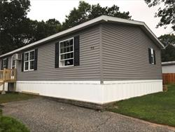 Financeable manufactured home in desirable family/pet friendly community. Buyer must be approved by Oakland Ridge. Spacious 3 bedroom, 2 full bath, living room, kitchen, dining rm. & laundry rm. Open floor plan, vaulted ceiling's, crown molding and wainscot paneling. Large yard. backs up green space. $640 mo. lot rent includes water, trash/snow removal and cesspool maintenance. Minutes away from all the North Fork has to offer, shopping, restaurants, wineries, beaches, boating, fishing & golf.