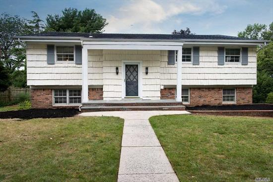 4 Bedroom 2.5 bath High ranch on great corner location. Hardwood floors throughout, huge eat in kitchen, separate dining room, large living room. wood burning fireplace, laundry room, 2 car garage. House is very clean but dated. You can move in and work to make it your own immediately.