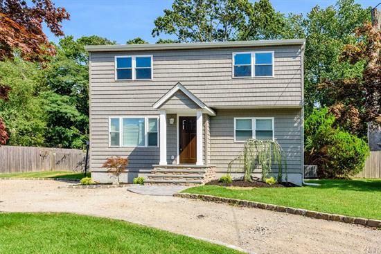 West Islip. Totally Renovated 6 Bedroom 2 Full Bath Expanded Cape. Hardwood Floors, EiK with Black Stainless Steel Appliances, Full Finished Basement, Large Property.