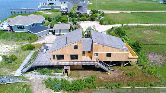 Don't miss this incredible opportunity to own a bay front home in the Village of Westhampton Beach for under 2m! Bring your contractor and turn this 4 bedroom, 2 bath contemporary into your dream beach house. Deeded ocean beach access is directly across the street.