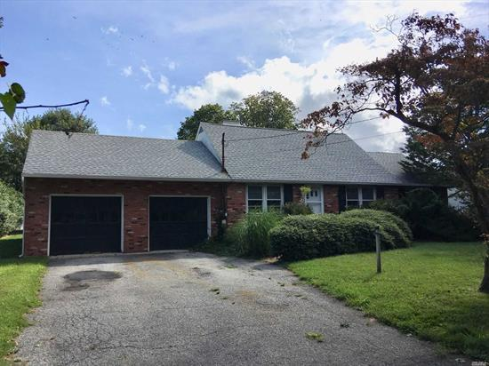 Good Size 7 Rm, 3 BR, 1.5 Bath Expanded Ranch with a 2.5 Car Garage on a Flat Mid block .53 acre. Home Sold in As Is Condition,  New Roof & New Boiler.....Needs Total Overhaul.....it's in Poor Condition.