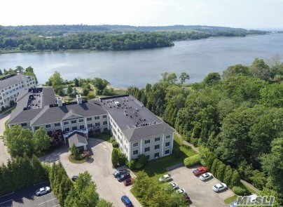 Roslyn. Luxury 55+ 2 Bedroom, @ 2 full Bath Rental on Roslyn Harbor. Indoor Parking, In-Ground Heated Pool, 24-Hour Doorman, Community Room and Fitness Center. Washer and Dryer are in the Unit.