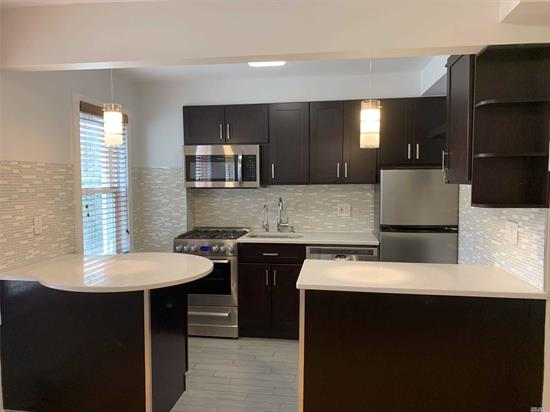 Renovated second floor apartment with all new appliances, washer & dryer in the unit, built in water filter. Large closets and hardwood floors throughout. No pets. Tenant pays electric and gas. 1 block from the subway & buses. Close to shopping & restaurants.