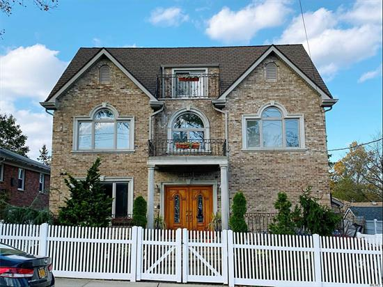 The luxury custom-built home located in the heart of Bayside. This home offers the finest amenities&finishes with the top quality. Brazilian mahogany entry door; Oak interior floor, doors&stairs; maple kitchen&bath cabinets; Andersen windows with a lifetime warranty, remote-controlled gas fireplace; central vacuum system... much more. #26 top-rated school dist., minutes walk to PS41, park&LIRR. Must see!