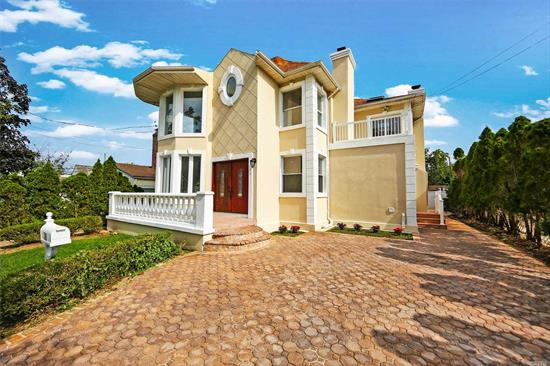 Professionally Designed & Renovated 3 Bedroom, 3.5 Bathroom Colonial with 3 fireplaces. Magnificent Hardwood Floors Throughout, Designer Kitchen W/ Stainless Steel Appliances, Custom built Cabinets, & Mosaic Tile Backsplash!! Custom Bathrooms W/ Beautiful Vanities, Tile & Premium Hardware!! Large Master En-Suite With Walk In Closet, Full Bathroom with standing shower and Jacuzzi & Vaulted Ceilings!! New Laundry, Stand up Attic, Full Finished Basement with Full Bath, Granite tiles Front Porch