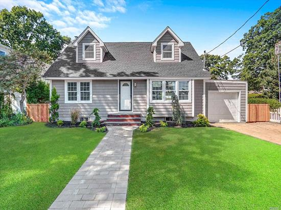 Completely Renovated 4 Bedroom 1 Bath Cape in Massapequa Park - Open concept Kitchen/Dining Room/Living Room, Hardwood Floors throughout, New Carpet in Bedrooms, New Roof, Windows, Siding, Kitchen with Granite & Stainless Steel Appliances, Full Basement, Partially Finished with Outside Entrance to Fully Fenced Yard with Deck of Dining Room....