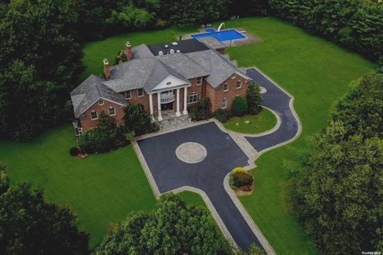 This Brick Colonial Masterpiece, That Sits On 3.1 Acres, With Gated Entry, & In Jericho Schools, Is A Towering Vision Of Stately Leisure! The 20' High Entry Foyer Features Radiant Heated Floors in Foyer, Den, Mstr Bth 2 Half Baths & Massive Eat-In Kitchen W/ Viking & Sub-Zero Appliances, The Grand Backyard Space Is Complete With Brick Patio, Impeccable Lawn, And Sizable Pool And Jacuzzi! Courtyard Driveway, 3-Car Garage, & 12' High Ceilings In The Basement Provide Unparalleled Accommodation!