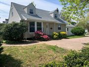 Beautiful Expanded Cape Offers everything you desire in a new home: 4 Spacious Bedrooms, New Kitchen with SS appliances and Granite countertops, 2 New Bathrooms, New Wood Floors, Central Air, Full Finished Basement, Newly constructed garage, Wooden Deck, Sliding doors from Dining room, Extra Large corner Lot, New PVC Fencing enclosing a spacious private Yard. This house is the one you have been looking for! Your search for a perfect home ends here! Come & View Today!