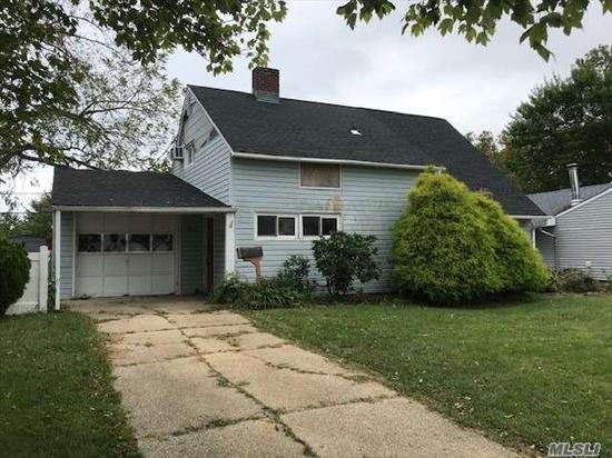 Levitt Ranch, features EIK, Living Room w/Fireplace, 4 Bedrooms, 2 Full Bathrooms, 1 Car Garage, Private Yard. New Roof. Great Opportunity to Remodel to Your Taste. Close to Shopping, Parkways, Schools, LIRR.