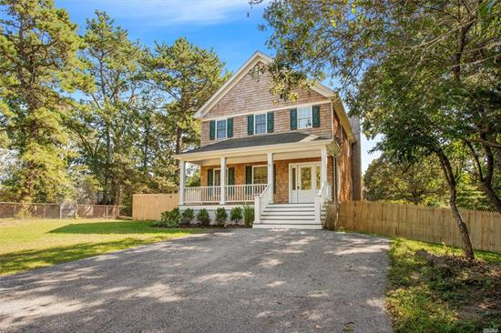 Completely refreshed, this shingled home offers 2300 sqft of comfortable Hamptons living. Situated on a .23 acre this property offers 4 Beds. 2.5 baths, CAC, new hardwood floors, a new kitchen with granite countertops, stainless steel appliances, a wood burning fireplace, and crown molding throughout. This home also offers a full basement with 11 ft high ceilings which can be finished as additional recreational or living space. Minutes from Reeves bay, Jitney station, and Montauk Hwy.