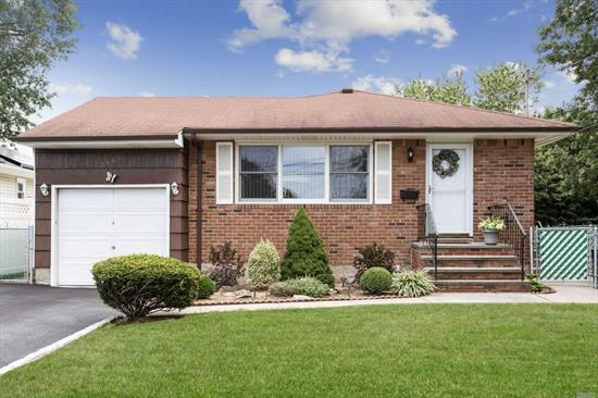 Welcome Into This Immaculate Well Maintained Light and Airy Ranch Style Home! Spacious Rooms Throughout. Eat in Kitchen with Wood Cabinets. Large Master with Half Bath and Large Closets. Hardwood Floors. Large Furnished Basement with Outside Entrance. Private Park Like Property with Fenced In Yard. This Is A Must See!