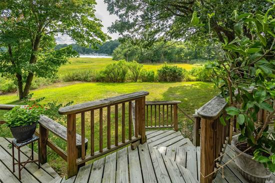 Secluded and Tucked Away. Mattituck Inlet Front. Featuring 4 Bedrooms, 2 Full Baths with a Bright, Open and Airy Layout. Beautiful Views from Both Upper and Lower Levels. Shared Deeded Dock for Small Vessels, Kayaking and Paddle Boarding! Close Proximity to Bailey Beach.