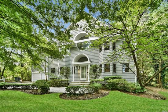 Spacious, Sun Drenched, and Sky Lit Contemporary C/H Colonial in The Village Of Great Neck Estates. A 30 Ft High Entry Foyer is adjacent to a Formal Living Room and Banquet Dining Room with Window Seat. The 17 Ft High Den has a Custom Built-In and Fireplace. The Eat-In-Kitchen leads to a Huge Blue Stone Patio Overlooking a Private Landscaped Yard. A Powder Room and Laundry Complete the First Floor. The Master Suite has Cathedral Ceilings and Spa Bath. There are 3 additional BR's and bath.