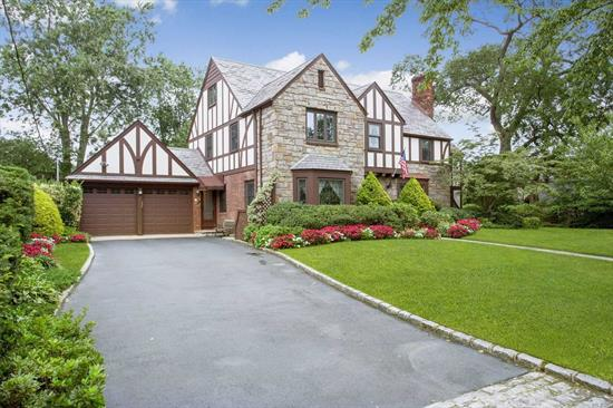 Spectacular, One-Of-A-Kind, Old World Quality Tudor on a beautiful block in the Incorporated Village. Stunning backyard with new semi-inground pool, Updated kitchen, incredibly spacious, all amenities. 4 Floors of finished living, 2 car G, Close to LIRR, Town, and Shopping. Must see to appreciate.