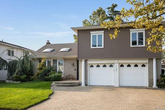 Move Right into this (Woodmere 400) large split level home with 4 bedrooms upstairs, 2.5 baths with updated kitchen featuring Wolf appliances, sub zero, pot filler etc. Beautiful hardwood floors throughout. Transferable flood insurance policy for $755 per year and unbelievably low taxes!