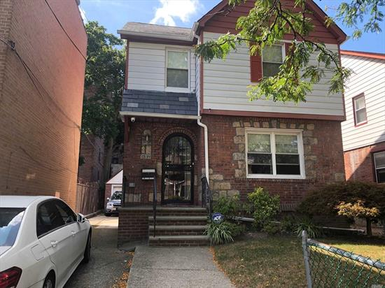 ONE OF A KIND DETACHED 35/100 COLONIAL BRICK DETACHED HOUSE THAT IS WELL KEPT HOME WITH UPDATED KITCHEN AND BATH, FEATURING 3 BED 1.5 BATH, EATING KITCHEN FULL FINISHED BASEMENT WITH SEPARATE ENTRANCE, DETACHED GARAGE AND BACK YARD,  STEPS TO SHOPPING, QUEENS BLVD, TRAINS MALLS ETC.