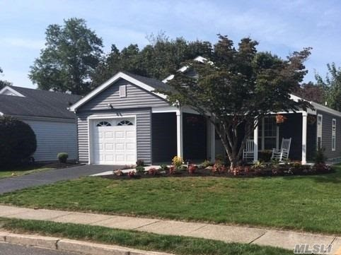 Completely Renovated 2 Br, 2 Bath, Ardmore Model. Includes New Roof, Siding, Wood Floors, All White Kitchen, S/S appliances, Quartz Counter Top, Baths, Carpet, Garage Door. Turn Key!
