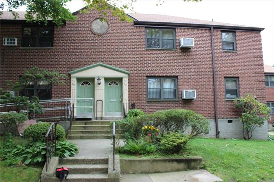 Nice and Sunny 2/3 bedroom lower unit co-op located in the much desired area of Douglaston. Maintenance Includes All Utilities. Apartment comes with new washer/dryer, refrigerator and AC unit. Zoned for the top Sd#26. Plenty of street parking available but unit also comes with 2 parking stickers.  Walking distance to the Express bus to Manhattan.