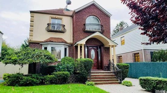 Magnificent Colonial House for RENT in Jamaica Estates! Custom built kitchen with top of the line appliances, Spacious living Rm, Formal Dining Rm, Library Rm, Huge family Rm with a wood burning fireplace. Massive master BdRm with lots of custom Built-in closets. Additional 3 BedRms & 3.5 Baths. Cameras/Security System & Beautiful Large Deck, Detached Garage/private driveway. 3 AC & 4 Heating Zones. Finished basement with recreation/play room, many closets & Laundry area. Conveniently located!