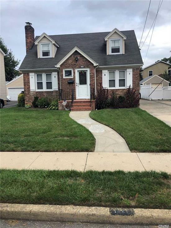 Very Nice One Family with Hardwood Floor, 3 Nice Bedrooms, 2 Full Baths. Well Kept Property, 100% Brick, Close To Shopping.