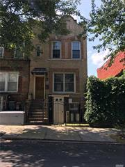 A unique find! Located on the Ridgewood border, close walk to the Jefferson L stop, this charming brick home, circa 1910, was lovingly gut-renovated and is move-in ready. Its secluded backyard is a private oasis featuring an ivy covered pergola, trees, and a built-in natural gas grill, perfect for entertaining.  On the main floor is a modern open kitchen and living space creating a loft-like feeling with 10+/- ft ceilings. French doors lead to the idyllic and serene backyard.